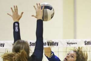 Shelby O'Neal slams the ball into Ranger defender Maddie McKay as Smithson Valley hosts Clemens in volleyball on September 19, 2017.