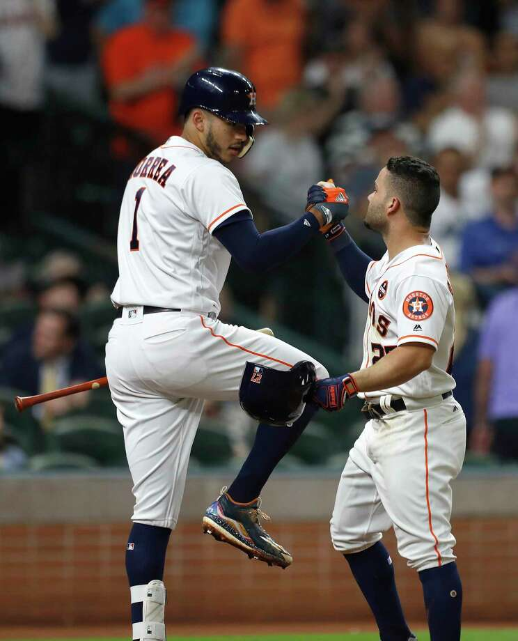 Teammate Carlos Correa, left, almost seems happier about Jose Altuve's game-tying home run in the fourth inning than the second baseman, who also Tuesday was named winner of the Lou Gehrig Memorial Award. Photo: Karen Warren, Staff / @ 2017 Houston Chronicle