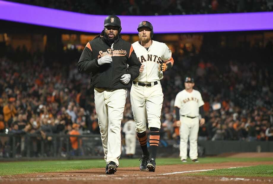 Johnny Cueto (front) is nearly passed by Hunter Pence after Pence homered with Cueto aboard in the fifth. Photo: Thearon W. Henderson, Getty Images
