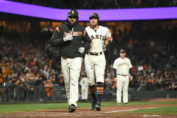 SAN FRANCISCO, CA - SEPTEMBER 19:  Johnny Cueto #47 (front) and Hunter Pence #8 of the San Francisco Giants (back) trots home together after Pence hit a two-run homer against the Colorado Rockies in the bottom of the fifth inning at AT&T Park on September 19, 2017 in San Francisco, California.  (Photo by Thearon W. Henderson/Getty Images)