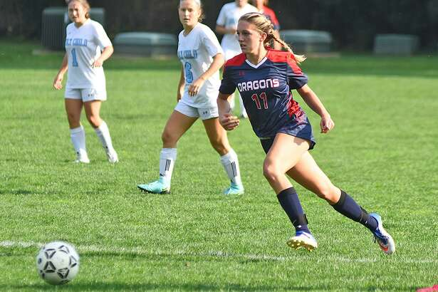 GFA's Bella Litt of Darien pushes the ball up the field during the Dragons' 1-0 win over Holy Child last week.