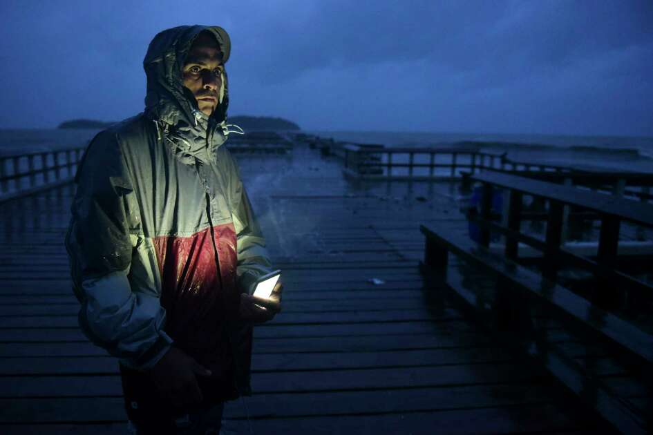 David Cruz Marrero watches the waves at Punta Santiago pier hours before the imminent impact of Maria, a Category 5 hurricane that threatens to hit the eastern region of the island with sustained winds of 165 miles per hour, in Humacao, Puerto Rico, Tuesday, September 19, 2017.