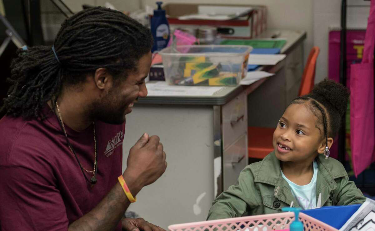 Fred Fitch, left, enjoying his time with his daughter, Amalia Fitch, 5, during her kindergarten class at School #14 on Dads Take Your Child to School Day Tuesday Sept. 19, 2017 in Troy, N.Y. (Skip Dickstein/Times Union)
