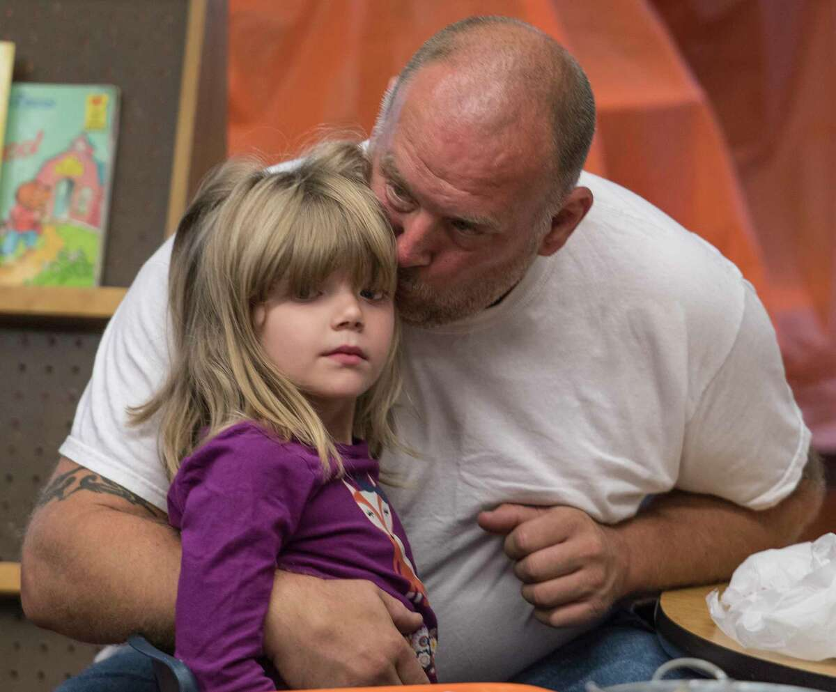 Ray Aubin gives his daughter Izabella 5, a smooch before the start of her kindergarten class at School #14 on Dads Take Your Child to School Day Tuesday Sept. 19, 2017 in Troy, N.Y. (Skip Dickstein/Times Union)