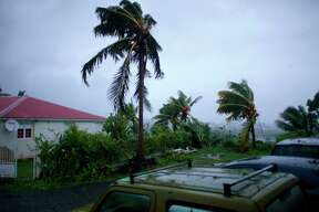"""A picture taken on September 19, 2017 shows the powerful winds and rains of hurricane Maria battering the city of Petit-Bourg on the French overseas Caribbean island of Guadeloupe. Hurricane Maria strengthened into a """"potentially catastrophic"""" Category Five storm as it barrelled into eastern Caribbean islands still reeling from Irma, forcing residents to evacuate in powerful winds and lashing rain. / AFP PHOTO / Cedrick Isham CALVADOS /          (Photo credit should read CEDRICK ISHAM CALVADOS/AFP/Getty Images)"""