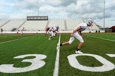 Lumberton's football team gets in practice on their field Tuesday. Like other area 22 5A schools whose schedules have been changed in the wake of Tropical Storm Harvey, they will play a mid-week game, traveling over an hour for their away game. Most players will get little sleep after getting home late and then having to be up early for school the next day. Photo taken Monday, September 19, 2017 Kim Brent/The Enterprise