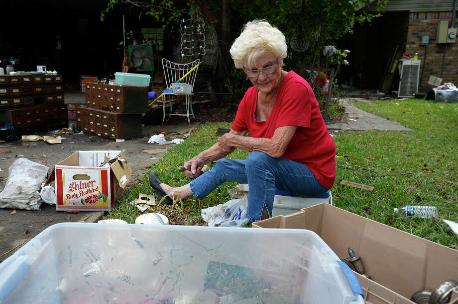 Barbara Maxwell sorts through some of her damaged things at her home in Bevil Oaks on Tuesday.  Photo taken Tuesday 9/19/17 Ryan Pelham/The Enterprise Photo: Ryan Pelham / ©2017 The Beaumont Enterprise/Ryan Pelham
