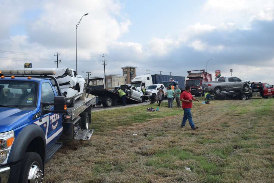 An inattentive garbage truck driver caused a seven-car pile up Wednesday morning on Interstate 10 on the East Side, police said. Photo: Caleb Downs / San Antonio Express-News