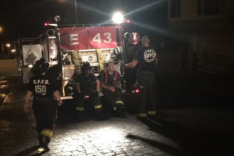 Firefighters at the scene of a blaze at a San Francisco home on Wednesday, Sept. 20, 2017. A man suffered critical injuries after a fire broke out at the residence, fire officials said.