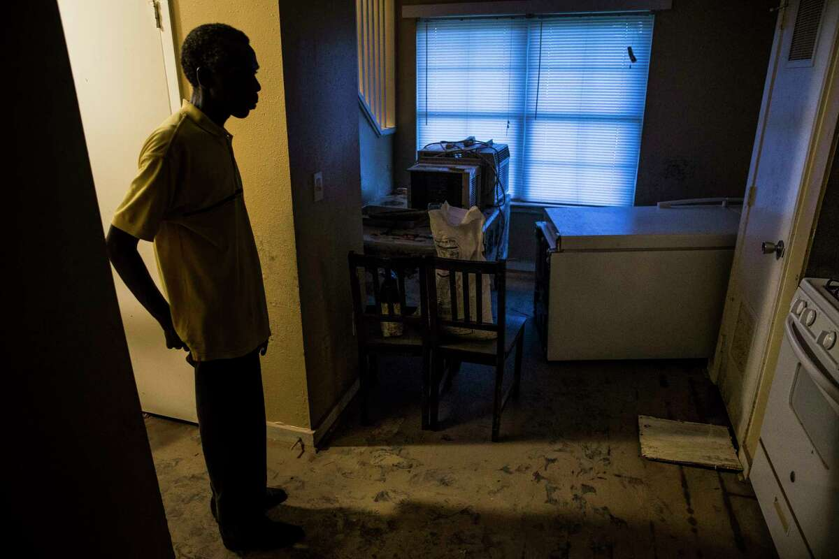 Damien Munyamariza stands in the kitchen of his former apartment at Clayton Homes Tuesday, Sept. 19, 2017 where he and other residents who were flooded during Hurricane Harvey were told that they must pay rent for apartments that were unlivable or lose their subsidies for public housing.