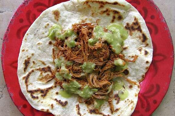 Deshebrada taco on a handmade flour tortilla from El Manantial Mexican Restaurant.