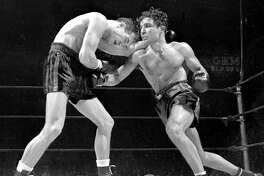 Jake LaMotta (right) throws a right and gets ready with a left in bout against Fritzie Zivic  (Photo by NY Daily News Archive via Getty Images)