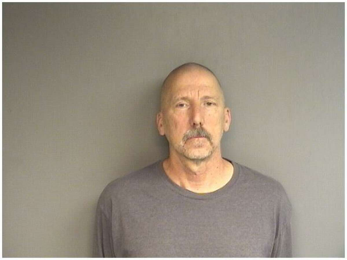 Ralph Esposito, 60, of Norwalk, was charged with stealing two checks worth $2,850 from a dying Stamford customer and cashing them after the woman died.