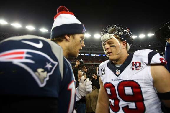FOXBORO, MA - JANUARY 13:  Tom Brady #12 of the New England Patriots greets J.J. Watt #99 of the Houston Texans after the 2013 AFC Divisional Playoffs game at Gillette Stadium on January 13, 2013 in Foxboro, Massachusetts.  (Photo by Elsa/Getty Images)