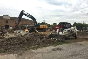 Work crews were in town over the weekend to demolish the former drive-thru restaurant that had been Red'z Rib Shack but is probably best remembered as Rally's. The building had sat vacant on the corner of Troy Road and Second Avenue for many years.