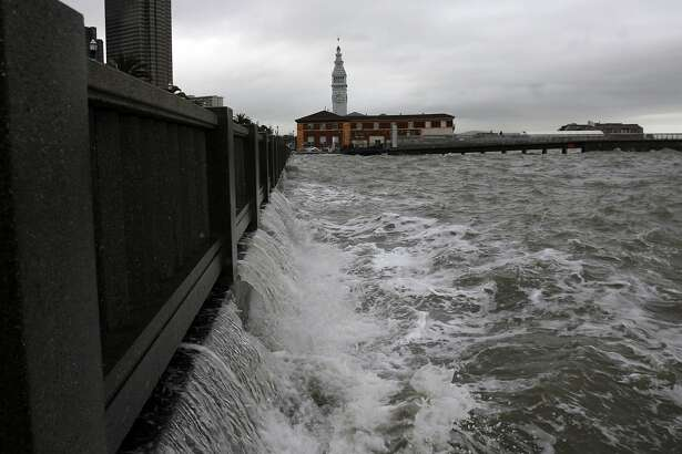 WEATHER_SF016_KK.JPG Water from waves from the bay spills back from the Embarcadero bnear Howard Streetas a winter storm hits San Francisco Tuesday. Photo by Kim Komenich/The Chronicle **