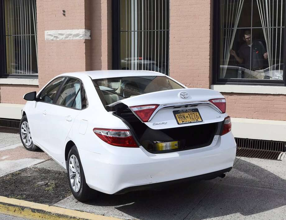 A car crashed into the Rensselaer County Department of Social Services building at 547 River St., in Troy, on Wednesday. Photo: Skip Dickstein / Times Union