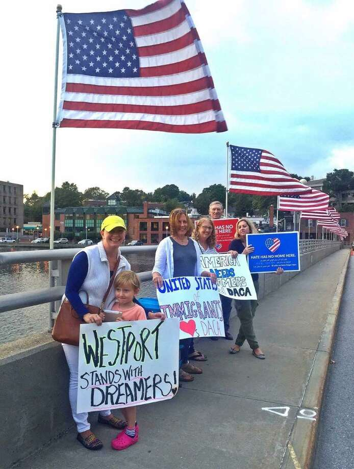 Protestors with DefenDemocracy of CT showed out in support of DACA on the Ruth Steinkraus Cohen Memorial Bridge in Westport, Conn. on Sept. 14, 2017. Photo: Contributed Photo / Contributed Photo / Darien News contributed