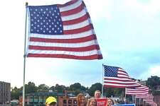 Protestors with DefenDemocracy of CT showed out in support of DACA on the Ruth Steinkraus Cohen Memorial Bridge in Westport, Conn. on Sept. 14, 2017.
