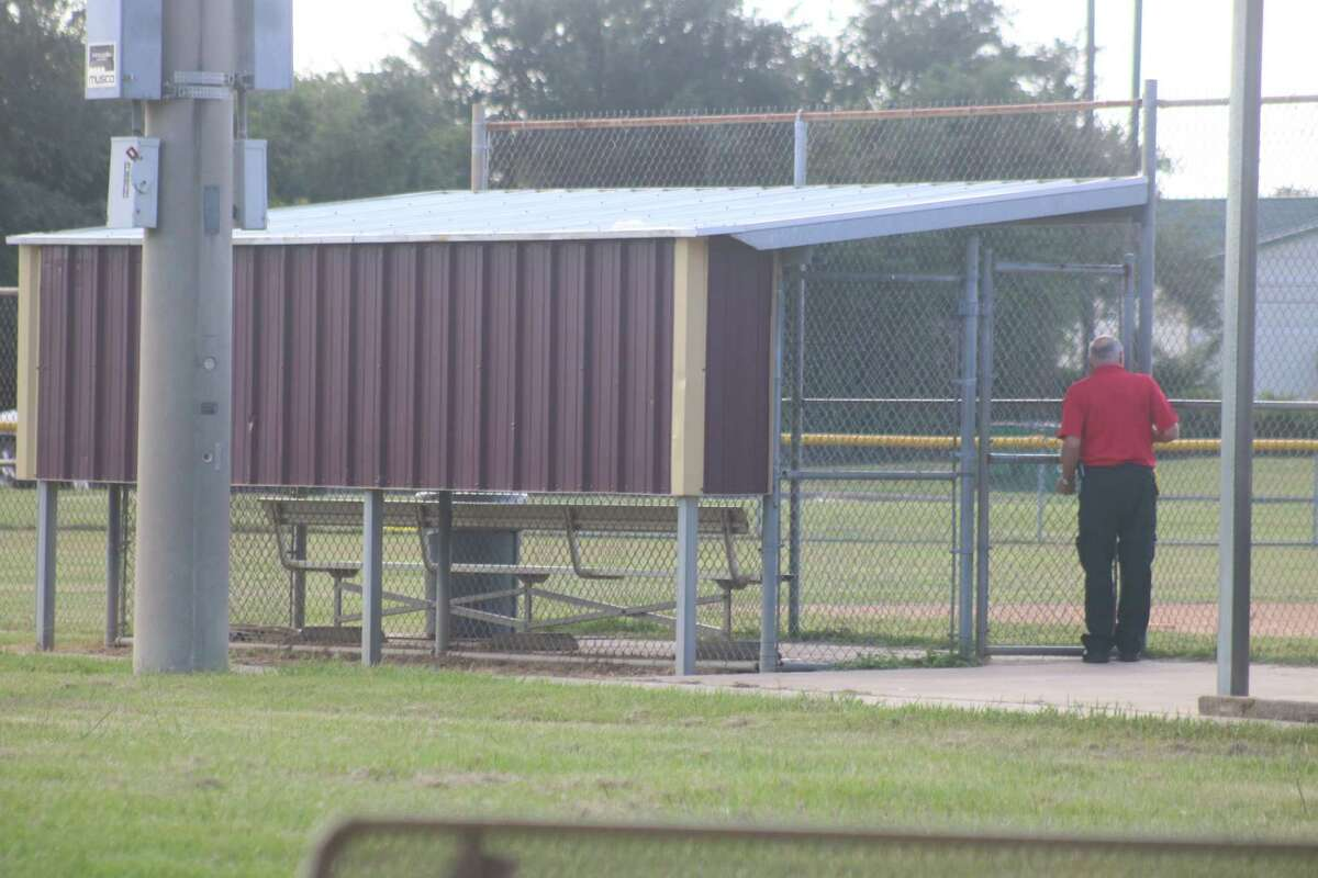 The dugout at a girls softball field where a body was found last Friday morning and just yards from where the cross country runners were competing.