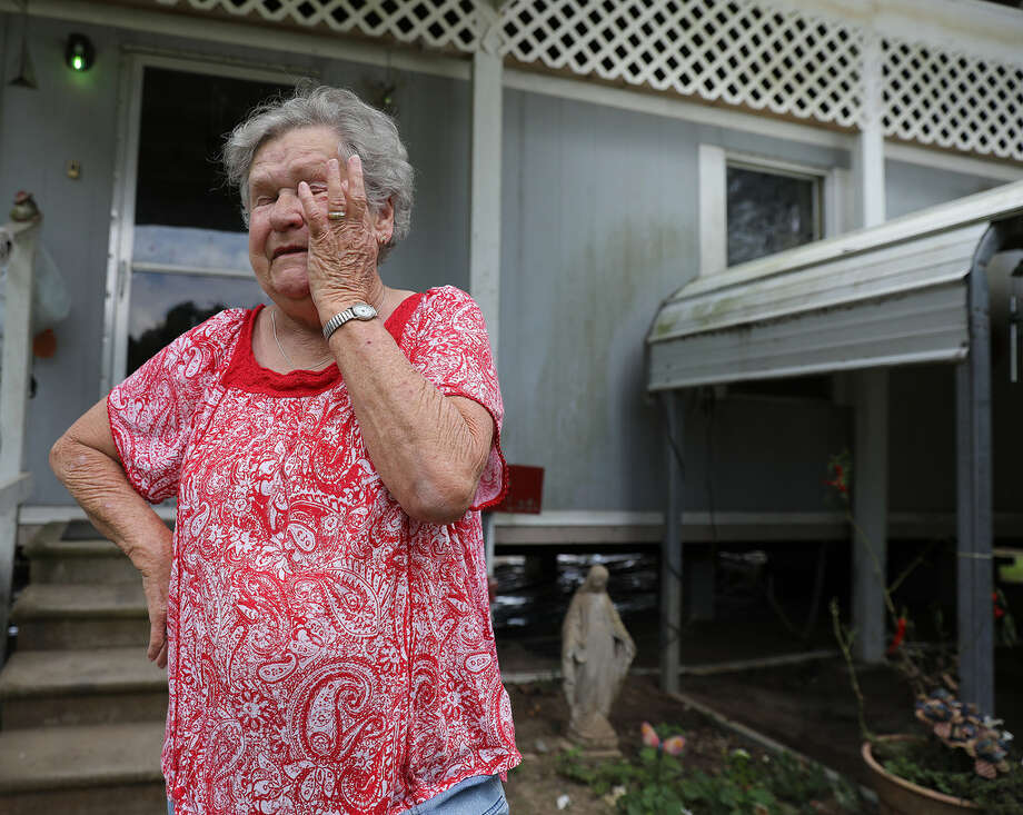 "Linda Satsky wipes tears away from her eyes as she talks about getting rejected from FEMA for assistance. ""I live on Social Security, I don't have extra money,"" said Satsky. Residents in Liberty, Texas talk about dealing the with aftermath of Hurriane Harvey onTuesday, Sept. 19, 2017. The National Weather Service estimates that Liberty County received more than 54 inches of rain when Harvey lashed the region late last month.>>>MAPS: See the areas of Greater Houston that were hit hardest by Hurricane Harvey, according to FEMA ... Photo: John D. Harden"