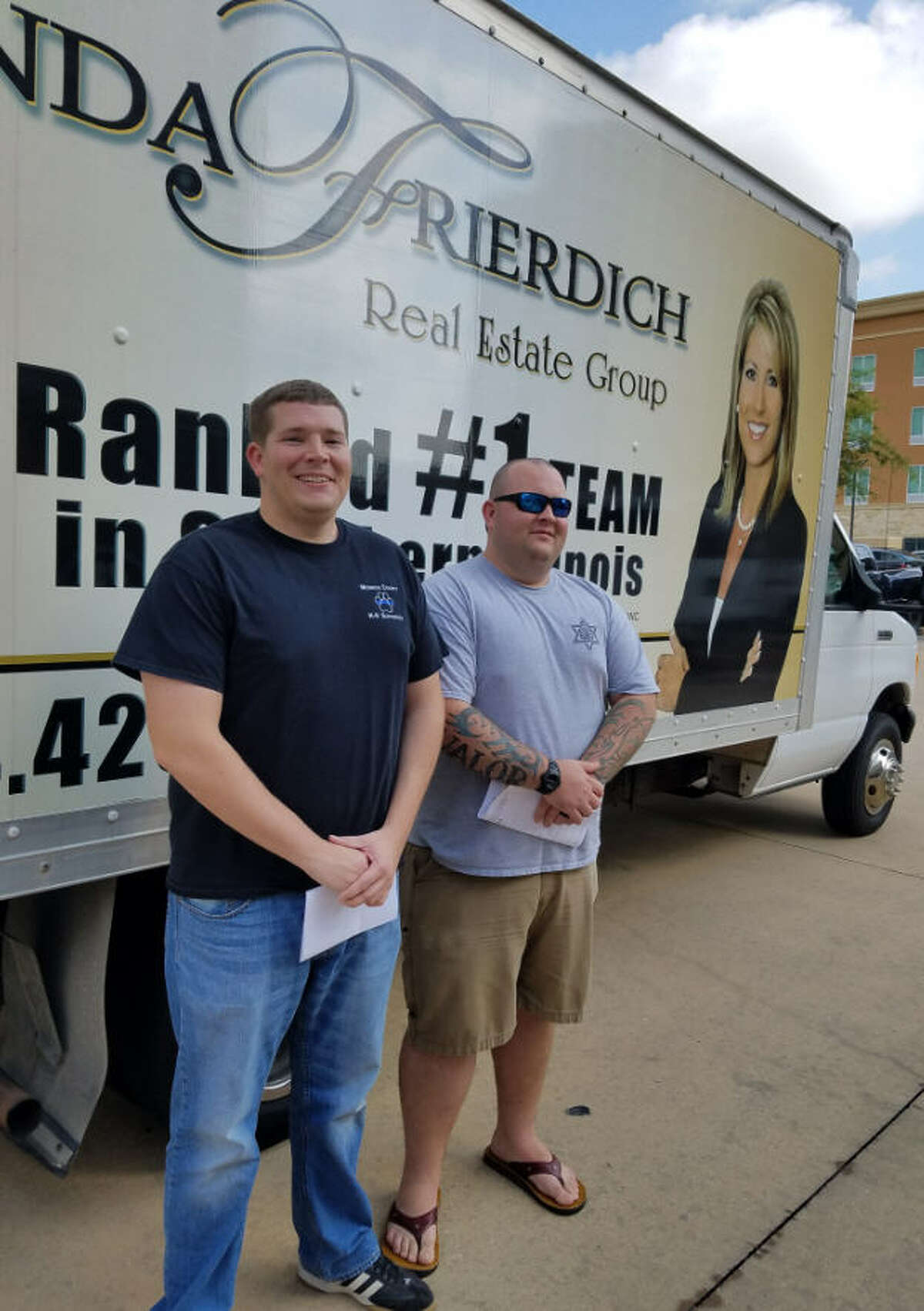 Century 21 The Linda Frierdich Real Estate Group of Smithton, Ill., collected donations for Hurricane Harvey victims and donated them to the Katy Lions Club for distribution. Monroe County Sheriff's officers Ben Ettling and Russ Brafford drove the truck of donations on Sept. 15 from Illinois to Katy.