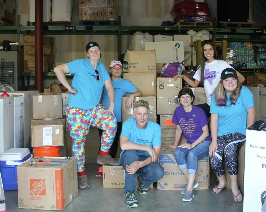 The Make It Fit Foundation, located in Ohio, sent volunteers, who drove over 1,300 miles to deliver a truck-load of autism related supplies and basic need items. From left, front row, are: Toryn Hudson, Darla Farmer, Hope For Three Executive Director, Randy Parker and Rebecca Eslinger; Back Row: Elizabeth Munoa, Hope For Three Family Assistance Coordinator &Operations Manager and Jenn Aguero, BCBA Photo: Hope For Three