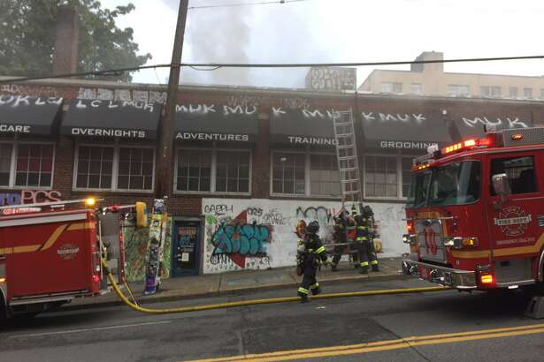 Seattle Fire Department firefighters responded to a large fire at 8:30 a.m. Wednesday at East Olive Way and East Denny Way. One woman was injured in the fire.