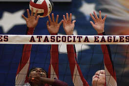Atascocita senior setter JaNay Wooten, top left, and senior middle blocker Nicole Hoyme (16) team up for a block against Summer Creek junior Amiya Matthews (8) during their district matchup at AHS on Sept. 19, 2017. (Photo by Jerry Baker/Freelance)