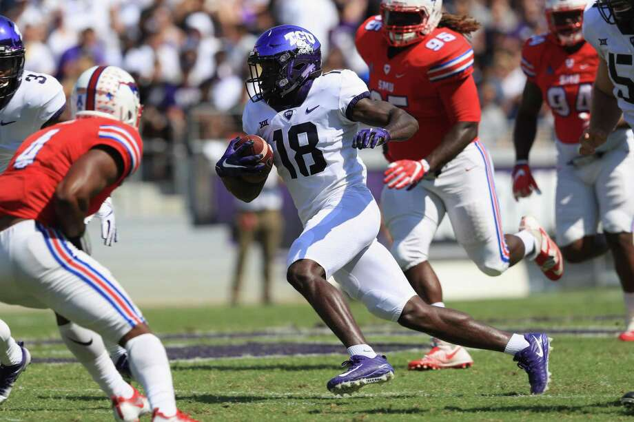 Jalen Reagor (18) of the TCU Horned Frogs runs for yardage against the SMU Mustangs in the first half at Amon G. Carter Stadium on Sept. 16, 2017 in Fort Worth. Photo: Ronald Martinez /Getty Images / 2017 Getty Images