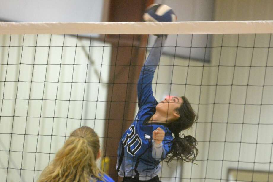 Plainview Christian Academy's Sarah Hooton connects on a hit during a volleyball match against Amarillo Ascension at the Eagles' Nest Tuesday. PCA swept Ascension in three sets. Photo: Skip Leon/Plainview Herald