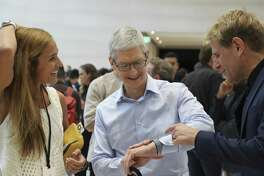 Apple CEO Tim Cook, center, in mid-September 2017 wearing an Apple Watch 3 at a product event in Cupertino, Calif. Under co-founders Dr. Shea Gregg and Dr. Kristin Gregg, Connecticut-based FallCall Solutions is developing a system for the Apple Watch to detect the severity of any fall by an elderly person and call for help. (Jim Wilson/The New York Times)
