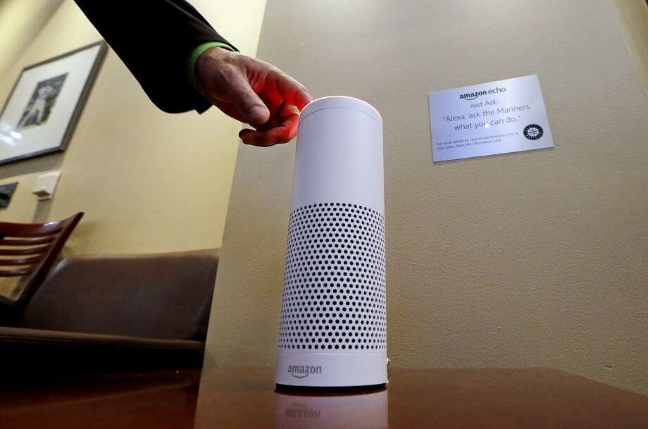 FILE - In this May 17, 2017, file photo, an Amazon Alexa device is switched on for a demonstration of its use in a ballpark suite before a Seattle Mariners baseball game in Seattle. Ally Bank customers can now ask their Amazon Alexa-enabled device to calculate how many working hours it will take to afford a purchase, the bank announced this week. Photo: Elaine Thompson, Associated Press