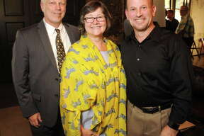 From left: Lee Ehmke, Beth White and Steve Wright at the Houston Parks Board's reception for Wright at a renovated fire house at 317 Sampson St. Tuesday Sept. 19, 2017.(Dave Rossman Photo)
