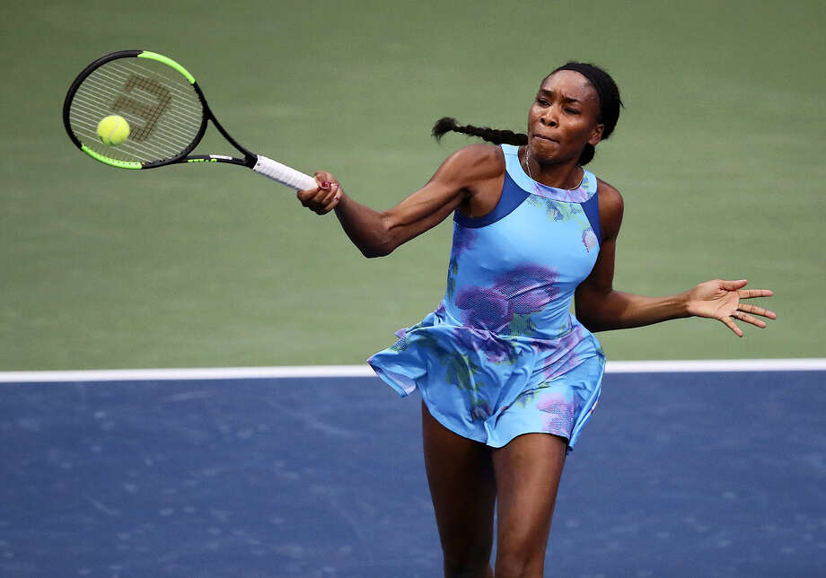 Venus Williams returns a shot during a recent tournament. Photo: Curtis Compton — Atlanta Journal-Constitution Via AP  / Atlanta Journal-Constitution