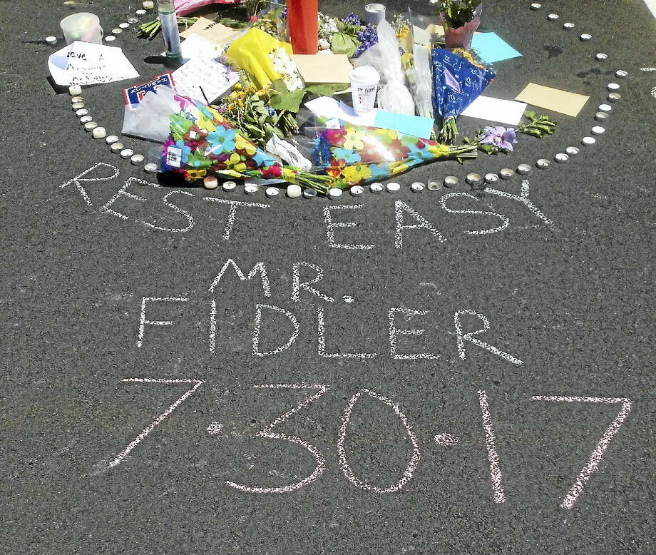 East Hampton High School held a tribute Monday for Principal John Fidler, who died Sunday. Photo: Jeff Mill — Hearst Connecticut Media