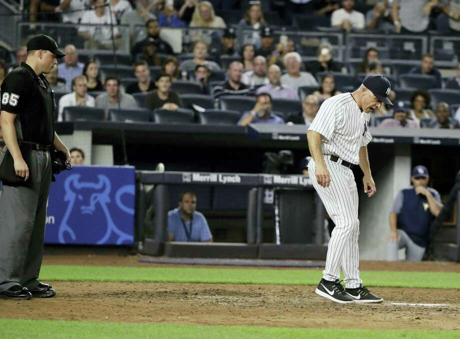 Yankees manager Joe Girardi argues a call with umpire Stu Scheurwater, left, during the seventh inning on Thursday. Photo: Frank Franklin II — The Associated Press  / Copyright 2017 The Associated Press. All rights reserved.