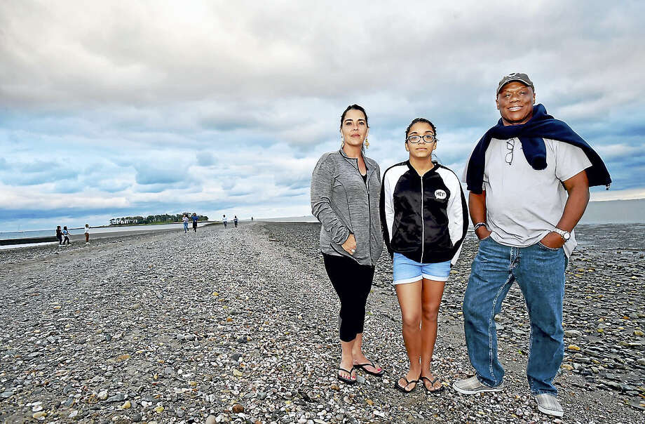 Renee and Joseph Williams and their 12-year-old daughter Nya, of New York, visit Silver Sands State Park, a public recreation area located on Long Island Sound in Milford Tuesday. Photo: Catherine Avalone / Hearst Connecticut Media  / Catherine Avalone/New Haven Register