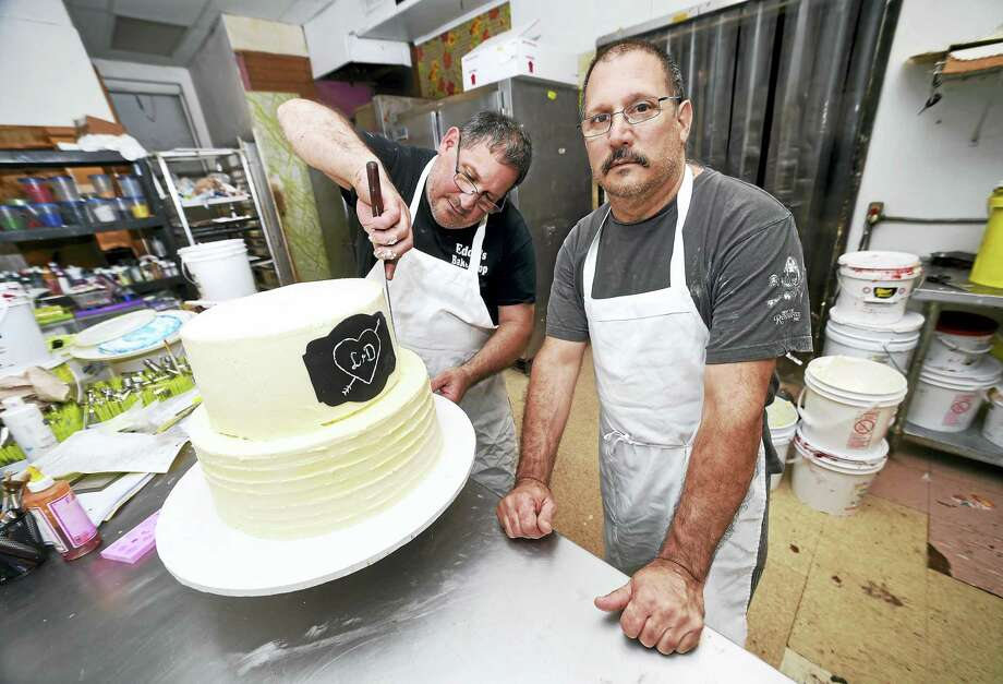 Arnold Gold / Hearst Connecticut Media  Brothers and co-owners of Eddy's Bake Shop, Paul (left) and Michael Ciocca, are photographed in back of the store in Ansonia on Saturday. The bakery is scheduled to close on Aug. 27. Paul is working on a wedding cake. Photo: Digital First Media