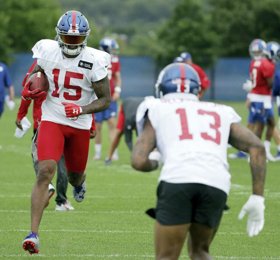 Giants wide receiver Brandon Marshall (15) runs with the ball as wide receiver Odell Beckham (13) pretends to defend during a drill Saturday in East Rutherford, N.J. Photo: Julio Cortez — The Associated Press  / Copyright 2017 The Associated Press. All rights reserved.