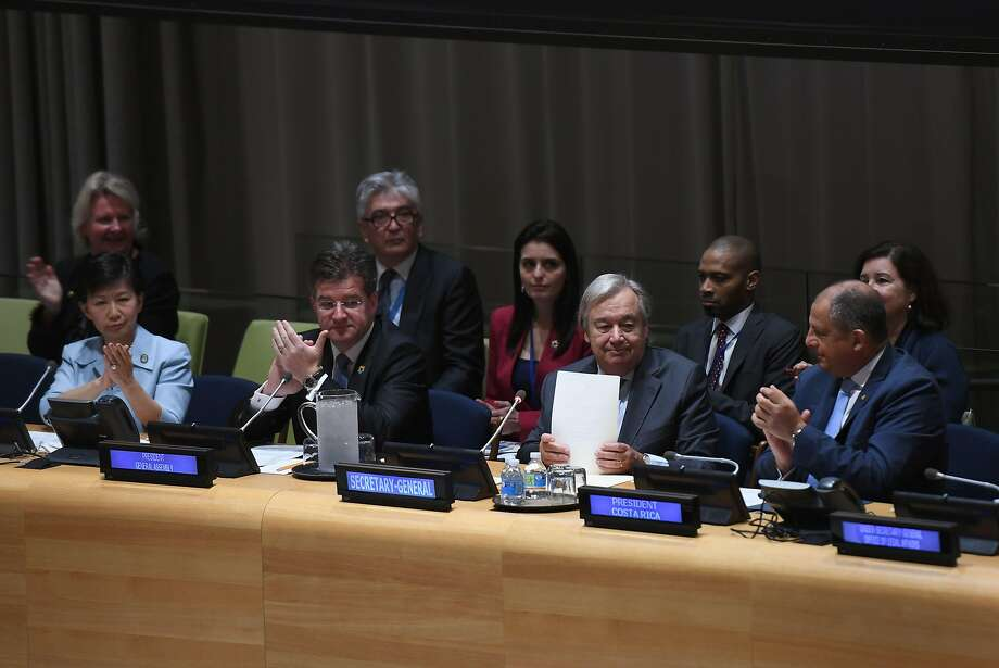 U.N. Secretary-General António Guterres (second from right) opens the signing ceremony for the Treaty on the Prohibition of Nuclear Weapons. Photo: DON EMMERT, AFP/Getty Images