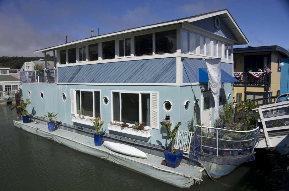 """7 East Pier """"Blue Pirate"""": 2,000 square feet, two stories Backstory: This steel-hulled barge, one of the few in the floating home community, was originally built by a Los Angeles shipbuilder for his personal use in 1963. Rumor has it that he was aiming for the Delta but stopped in Sausalito, fell in love -- and never left. Over 15 years ago, this was a scruffy boat with little to commend its exterior. Then, the cable network HGTV upgraded the look for an episode on its """"Curb Appeal"""" program. The show's designers came up with an update on a Caribbean theme. They did an amazingexteriormakeover, adding picture windows, etching a front-door seascape, adding flower boxes, and more. This is the exterior design you see today. Owner: Elana Yonah Rosen and her 15-year old son love the sense of community, proximity to the ocean & the city -- plus the stellar neighbors. Photo: Emilyriddell.com"""