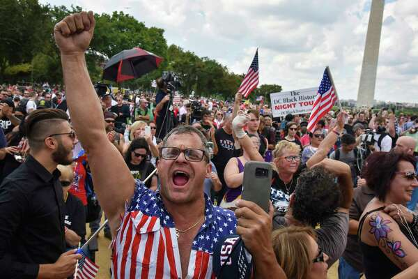 At the Mother of All Rallies, a pro-Trump gathering in Washington, Rob Cortis of Livonia, Mich., joins the crowd in singing the national anthem.
