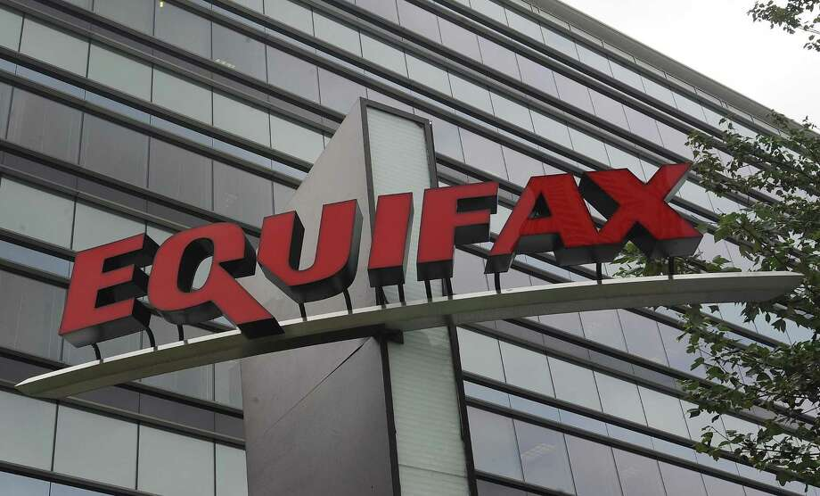 Signage at the corporate headquarters of Equifax Inc. in Atlanta. New York Attorney General Eric Schneiderman is pressing credit monitoring companies TransUnion and Experian to explain what cybersecurity they have in place to protect sensitive consumer information following a breach at Equifax, discovered by the company in July. It exposed the data of 143 million Americans. (AP Photo/Mike Stewart) Photo: Mike Stewart /Associated Press / Copyright 2017 The Associated Press. All rights reserved.