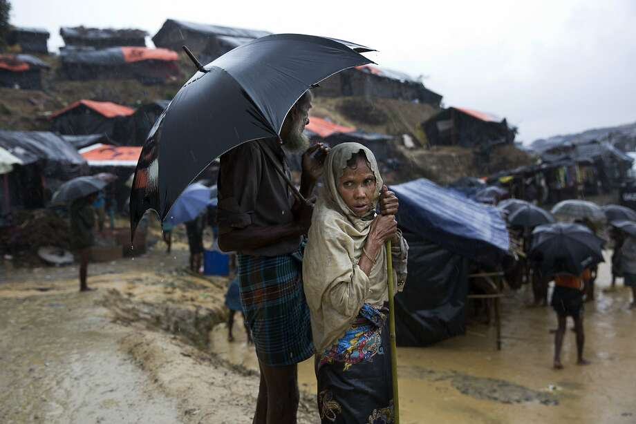 A Rohingya Muslim woman who fled violence in Myanmar stands drenched from monsoon rains at Balukhali refugee camp in Cox's Bazar, Bangladesh. Photo: Bernat Armangue, Associated Press