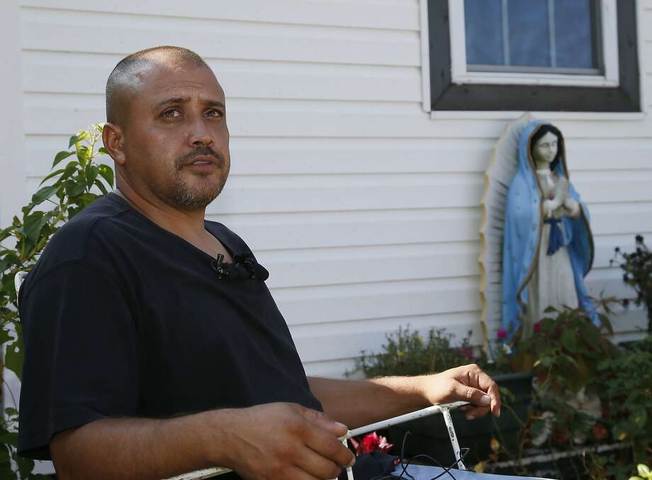 A neighbor who declined to give his name discusses the police shooting of Magdiel Sanchez. Photo: Sue Ogrocki, Associated Press