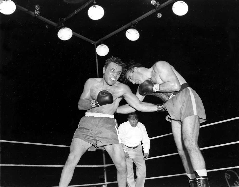 Jake LaMotta (left) pounds French boxer Marcel Cerdan in third round of a 1949 world middleweight title bout in Detroit. LaMotta won the title by a knockout in the 10th round. Photo: Associated Press