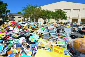 """The Harris County Public Library is looking for sites to provide services while its Barbara Bush and Katherine Tyra at Bear Creek and branches are closed indefinitely due to flooding caused by Hurricane Harvey. Losses are pegged at $2.2 at Bush, above, and Tyra, said Edward Melton, library director, """"in terms of materials, furniture, supplies and technology."""""""