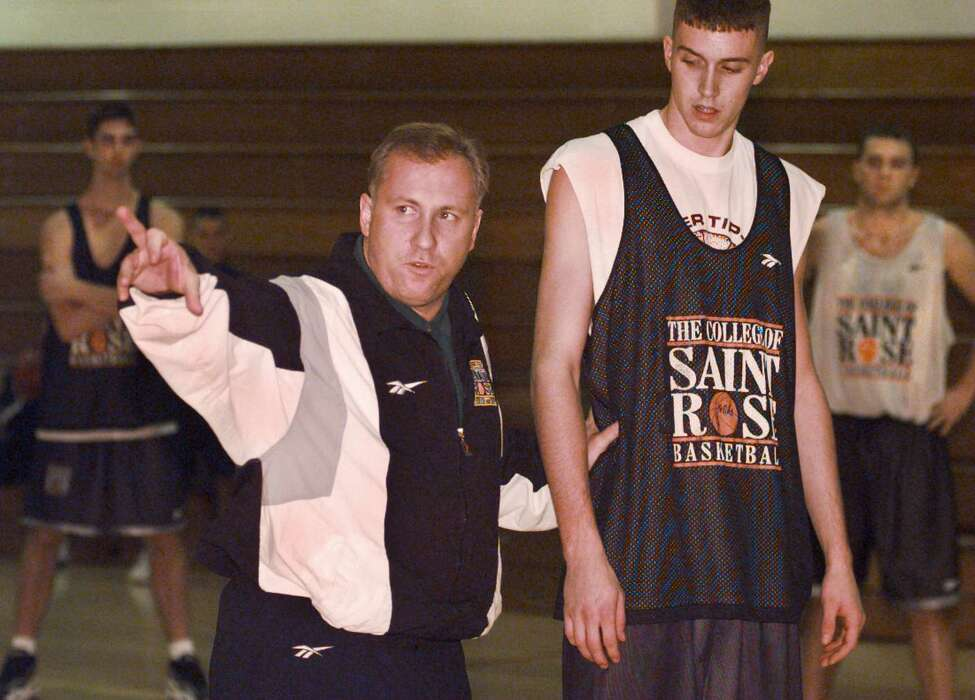 College of Saint Rose men's basketball head coach Brian Beaury instructs his team during practice on Nov. 7, 1997.