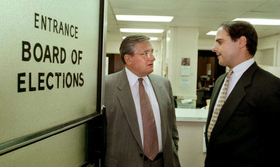 Times Union staff photograph by John Carl D'Annibale: Albany County Board of Elections Commissioners George Scaringe,left, and Michael Monescalchi at the County Board of Elections in the Albany County Courthouse Thursday October 9,1997. FOR HUREWITZ STORY